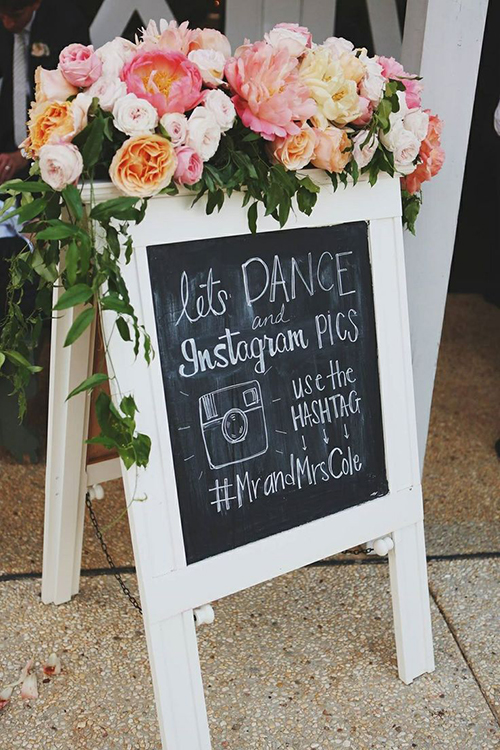wedding-hashtag-chalkboard-with-flowers