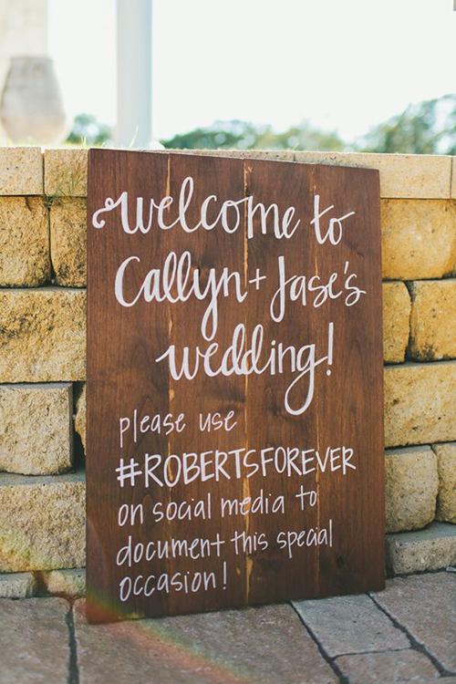 calligraphed-wedding-hashtag-sign