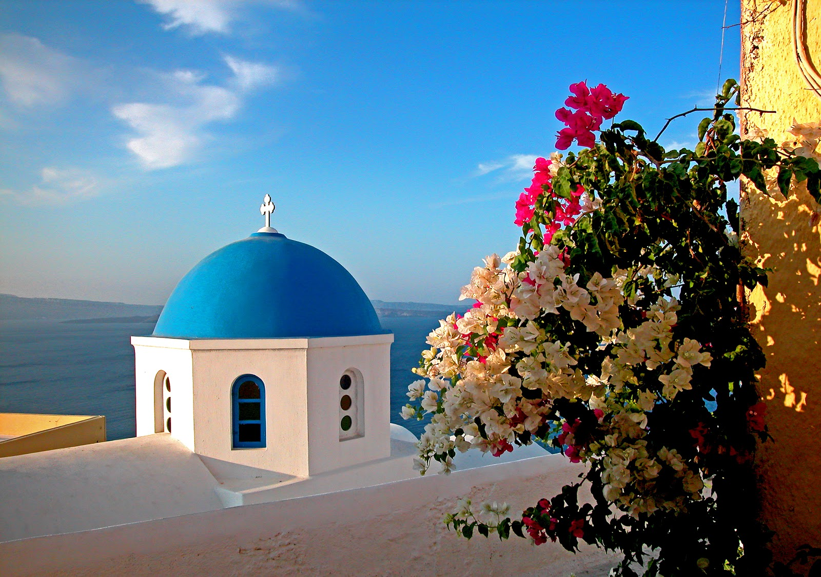 Oia blue dome with flowers